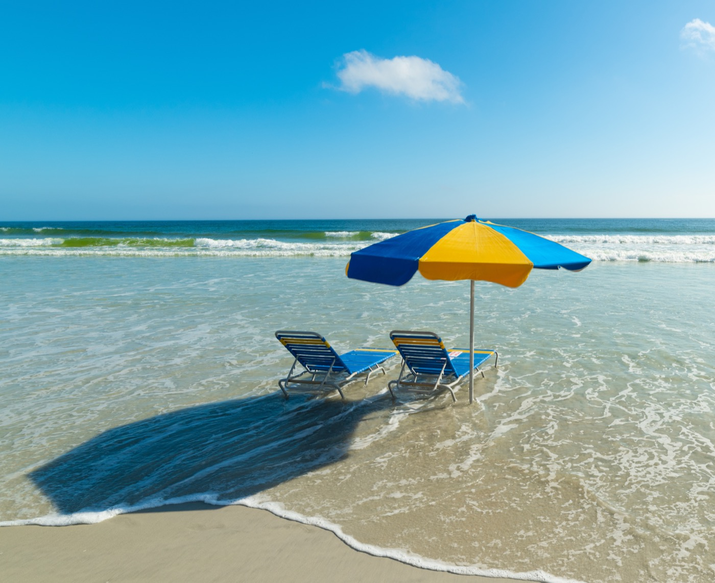Beach chairs and beach umbrella in Daytona Beach